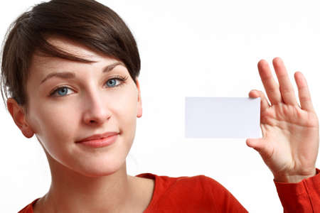 beautiful girl holding an empty card ready to be filled with some text Stock Photo - 7434246
