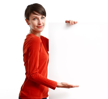 beautiful girl holding an empty white board ready to be filled with some text Stock Photo - 7434210