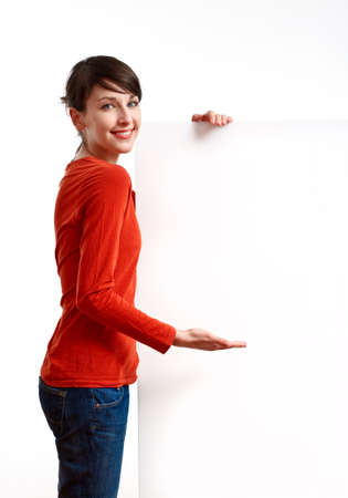 beautiful girl holding an empty white board ready to be filled with some text Stock Photo - 7434240