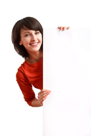 beautiful girl holding an empty white board ready to be filled with some text Stock Photo - 7434225