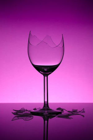 reflect: broken wine glass on pinkpurple background Stock Photo