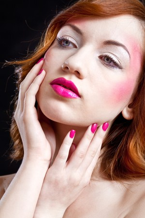 closeup of a girls face - pink lips and nails Stock Photo