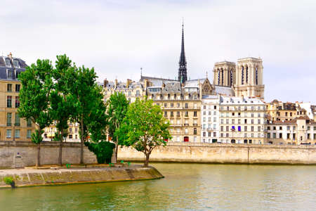 quayside: Paris - view on Seine river, Notre Dame and a quayside with buildings and trees Stock Photo