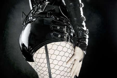 woman in black latex uniform photo