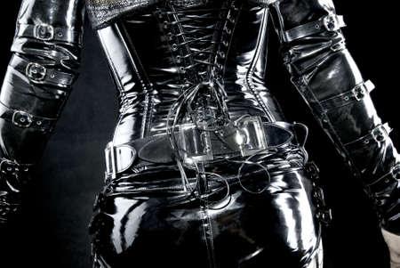 woman in black latex uniform, corset, back