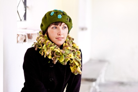 fashionable young woman wearing green beret and original scarf