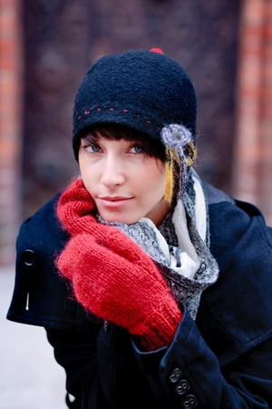 young woman wearing black hat and looking to the camera Stock Photo