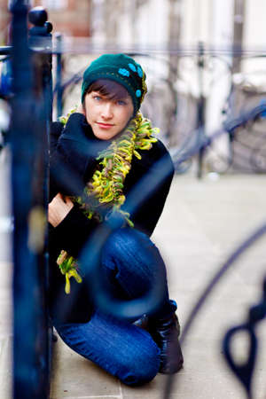 fashionable young woman wearing green scarf and hat
