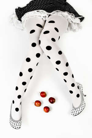 shaped legs, dotted tights, and four apples - conceptual