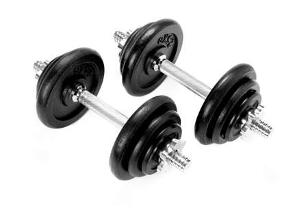 two metal dumbbels, black and silver, on white