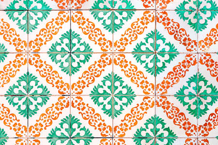 old green and orange colored azulejos - hand painted tiles from Lisbon Stock Photo