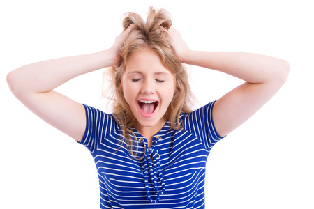 screaming head: beautiful blond girl screaming with hands on her head, isolated