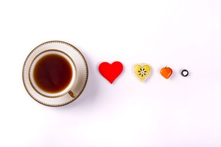 cup four: classic cup of tea and four different hearts on white background Stock Photo