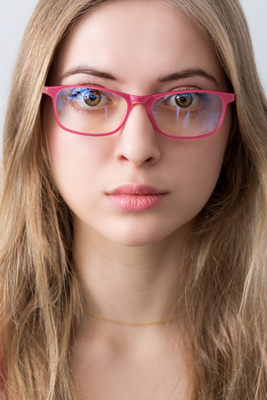 portrait of young wooman with pink glasses and lips Stock Photo