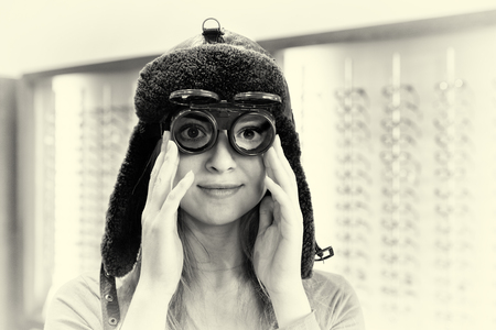 smiling woman with metal welding glasses and big furry hat Stock Photo