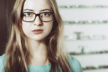 portrait of young woman wearing glasses - vintage color style, high-key Stock Photo