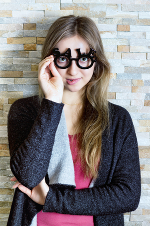 woman with glasses shaped into SALE text biting her lips