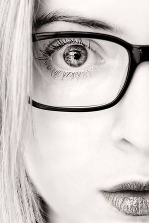 closeup of and eye and iris of a woman with glasses