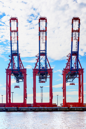 Hamburg, Germany, 2014.10.21 - three big cranes in an international container terminal