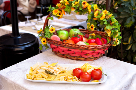 composition of many sorts of italian pasta in front of an italian restaurant