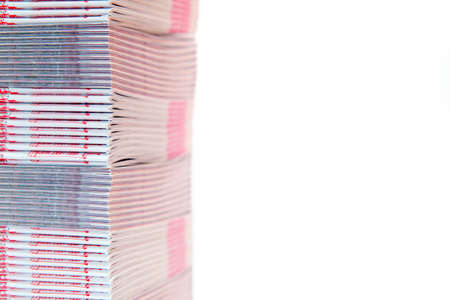 stack of printed materials stacked alternately - shallow DOF - with empty copy space
