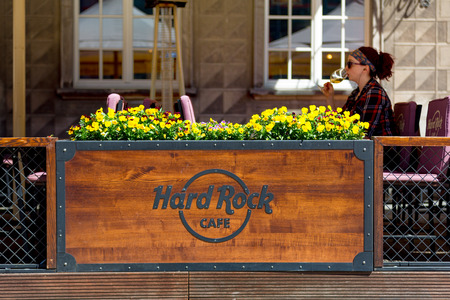 Gdansk, Poland 19 052017 - outside of Hard Rock Cafe - logotype with girl drinking wine in the background