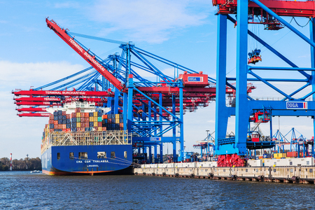 Hamburg, Germany, 2014.10.21 - cargo ship full of containers in international container terminal Editorial