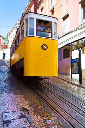 Lisbon, Portugal, 2016 0 23 - yellow tram - Ascensor da Gloria standing on the rails Editorial