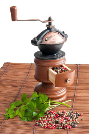 pepper grinder: Pepper grinder different sort of peppers and some parsley leaves