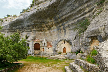 San Bernabe chapel is built inside natural caves eroded by Guareña river  Stock Photo