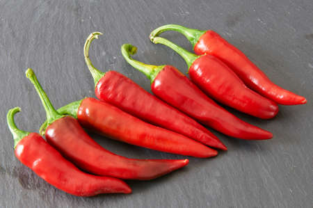 stale: Red hot chili peppers on a black stale tray