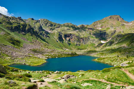 tourism in andorra: Tristaina high mountain lakes in Pyrenees. Andorra. Stock Photo