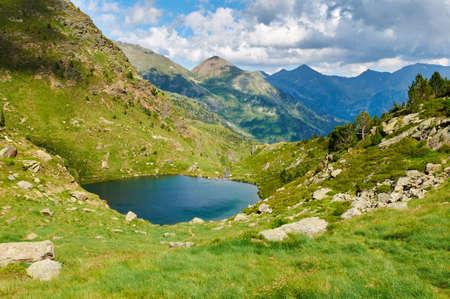 mountain peaks: Tristaina high mountain lakes in Pyrenees. Andorra. Stock Photo