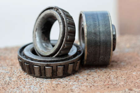 chock: Old and rusty ball bearing, isolated on white background