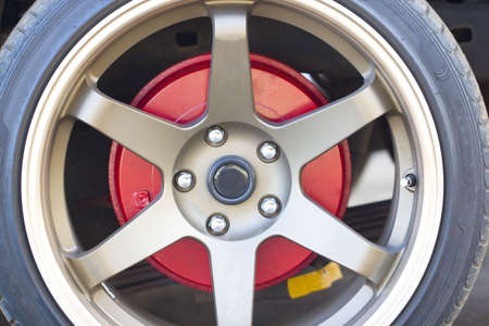 brake caliper: Wheel closeup with brake disc and caliper, alloy wheels