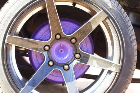 Wheel closeup with brake disc and caliper, alloy wheels