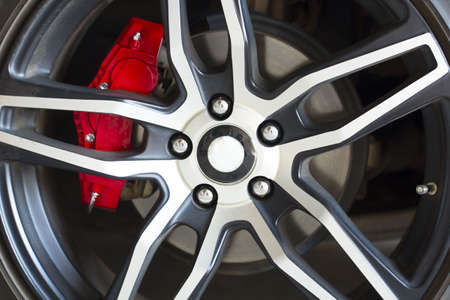 Sport vehicle disc brake and alloy wheels detail.