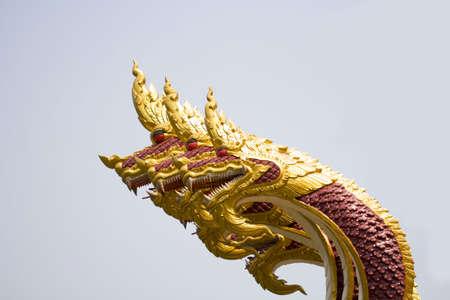 naga china: close up of naga head statue protecting the entrance to Thai temple Stock Photo