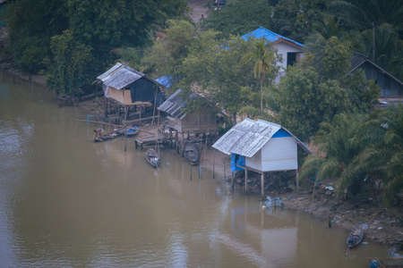 old house community along the water canal,in Thailand Stock Photo