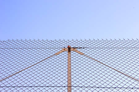 chainlink fence: Chainlink fence blue sky background Stock Photo