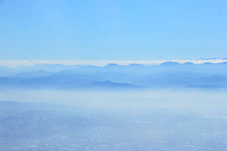 Blue mountain in the fog