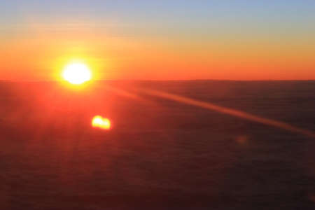 Beautiful sunrise cloud sky, view on airplane