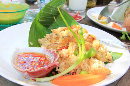 Thai cuisine fried rice with crispy fish