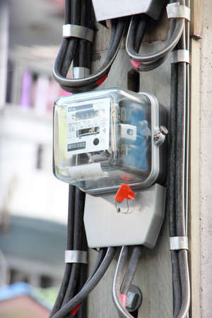 Home electric meter box on pole Imagens