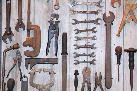 Old tool on wooden board