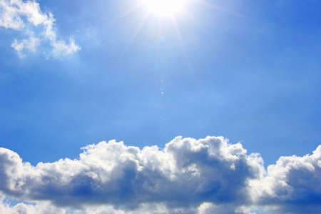 Cloud and sunlight beam with blue sky background