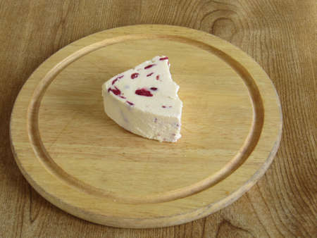 wensleydale: Wensleydale cheese with cranberries on a breadboard Stock Photo
