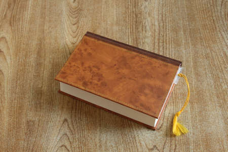hard cover: A closed hard cover book with a book marker