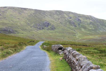 connemara: View of a narrow mountain road in Connemara, Ireland  Stock Photo