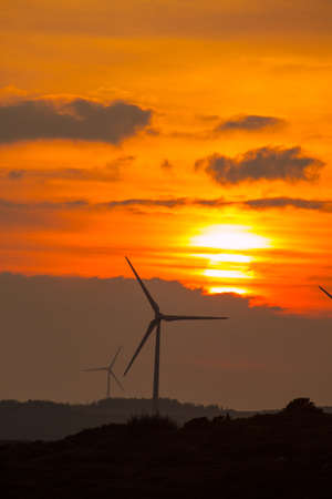 windfarms: Sunset with wind turbines at Barna Co. Galway Ireland. Stock Photo